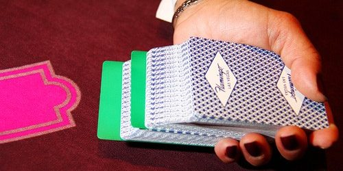 Photo Of Deck Of Cards In Dealers Hand Over Table Game At The Flamingo Las Vegas