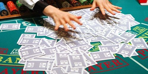 Photo Of Deck Of Cards Scattered On A Gaming Table Being Shuffled At The Flamingo Las Vegas