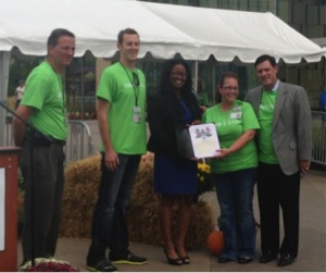 Representative Reece presenting the Horseshoe Cincinnati with a proclamation recognizing the inaugural Hometown Market.