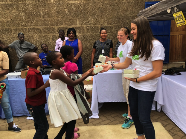 Caesars Entertainment volunteer distributes soap with Clean The World in Zambia