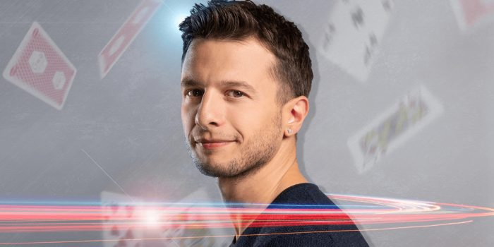 Mat Franco in front of a night sky curtain with his name lit up