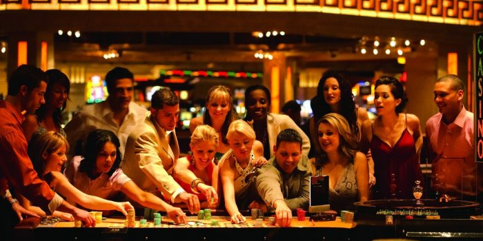 Group Of Guests At The Roulette Wheel Inside Caesars Windsor Casino