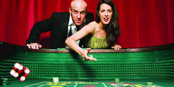 Image Of A Man And Woman Playing Craps Inside Bally's Las Vegas Casino