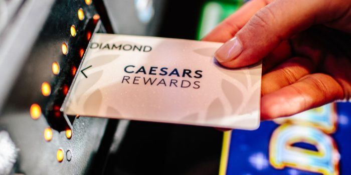 Hotel guest receiving Total Rewards loyalty program card