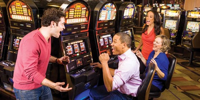 Photo Of Guests Playing Slot Machines Inside Harrah's Cherokee Casino
