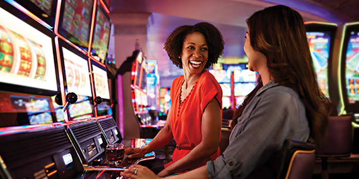 Women playing slots