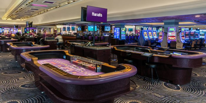View Of Inside Of Casino Showing Gaming Tables, Slot Machnes And A Bar Inside Harrah's Las Vegas