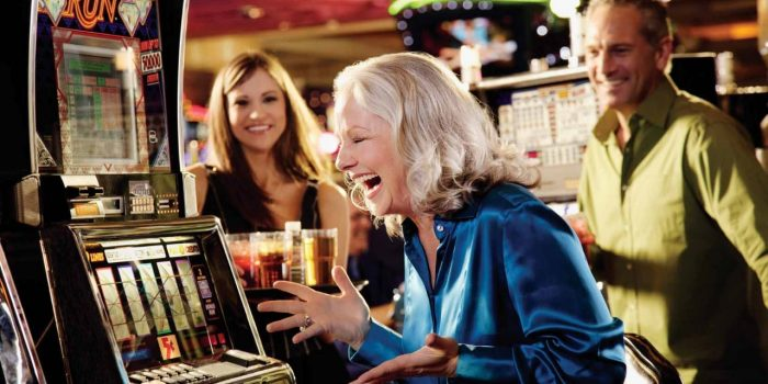 Woman Showing Excitement While Playing Slot Machine