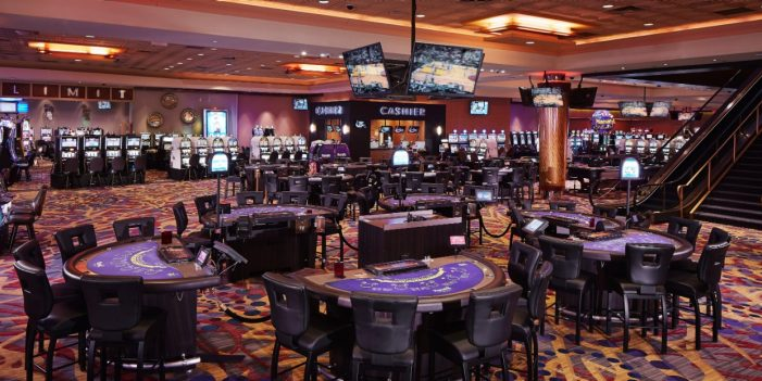 View Of Gaming Tables, Flat Screen TV's And Cashier Booth Inside The Casino At Harrah's North Kansas City