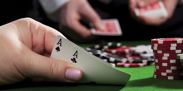 Photo of Person Holding Two Aces