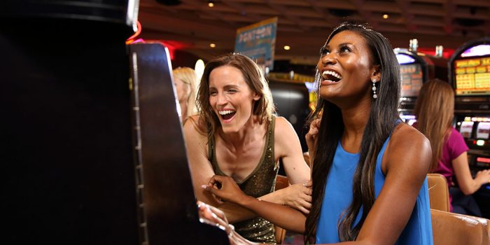 Women celebrating slot win