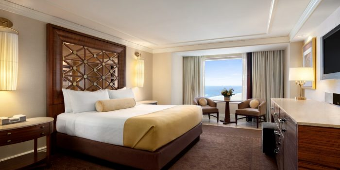 Photo Of Ocean View Room Showing Queen Bed, Dresser, TV And Sitting Area At Caesars Atlantic City