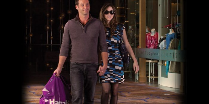 Photo Of Couple Holding Hands Walking And Carrying A Shopping Bag At Harrah's Cherokee
