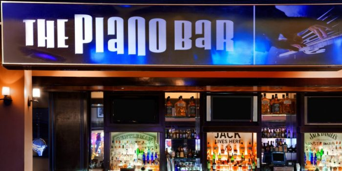 View Inside The Piano Bar Showing Whiskey Themed Pianos, Bar, And Sitting Area Located Inside Harrah's Las Vegas