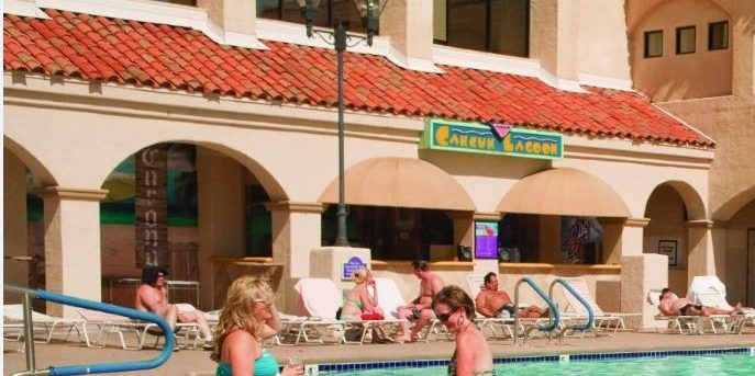 People Lounging By The Pool At Harrah's Laughlin