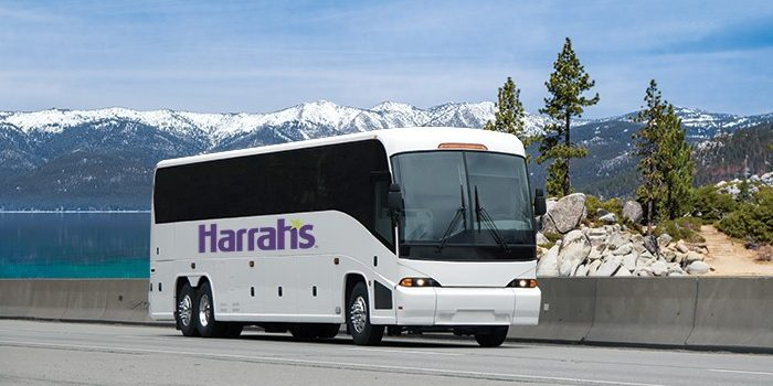 Harrah's Shuttle Bus Driving Down The Road With Mountains In The Background From Harrah's Reno