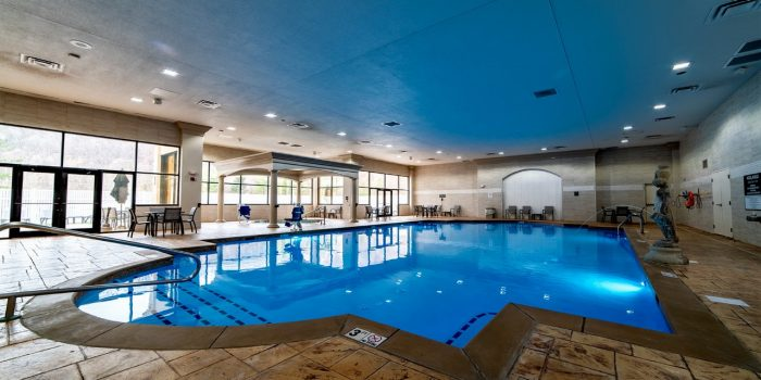 View Of The Indoor Pool With Tables And Chairs Located At Horseshoe Southern Indiana