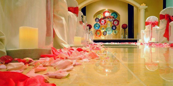 View Inside The Planet Hollywood Chapel Showing Covered Chairs, Rose Pedals, And Decorated Platform