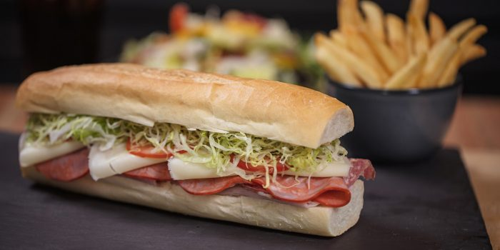 Turkey and Salami Sub With Cheese, Lettuce, and Tomatoes And A Side of French Fries