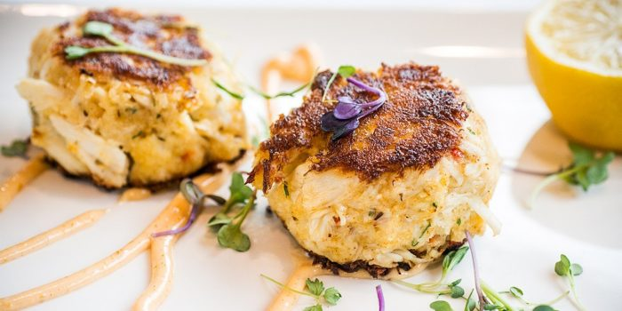 Plated Crab Cakes With Lemon Garnish From Jack Binion's Steakhouse inside Horseshoe Southern Indiana