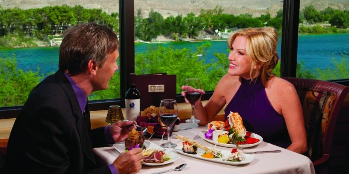 Couple Enjoying Dinner And Wine With River View At Range Steakhouse Inside Harrah's Laughlin